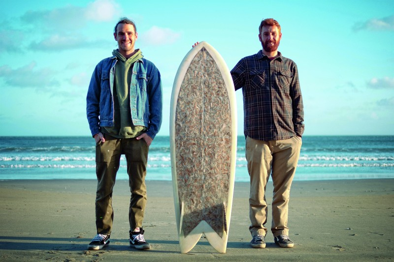 Ben Judkins and Taylor Lane with the Cigarette Surfboard